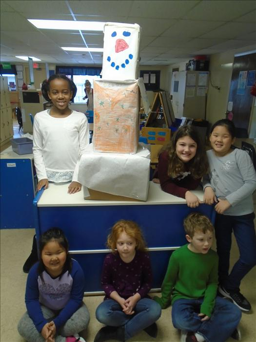 "The School Age students standing next to their ""Olaf"" wearing a Hawaiian shirt (because he wishes it was summer)."