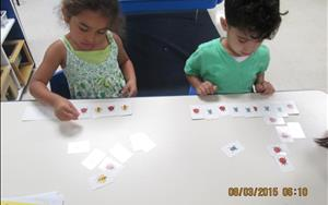 During Math Activities the students are given opportunities to match, sort, and classify - all problem solving skills. In this photo the students are using these skills to produce patterns.