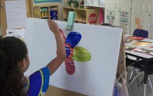 Pre-kindergarteners work on expressing their individual creativity through art.