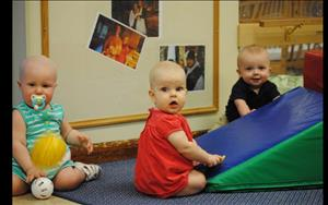 Infants enjoy playing together.