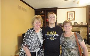 Marybeth and Ms. Bev with former student graduating #1 in his class at Bettendorf High.