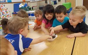 Our Discovery Preschool (two-year-old) class discovering soil and how we use it to plant seeds that grow into all different kind of things.