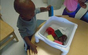 sensory exploration with water and sponges was wet and wild fun!