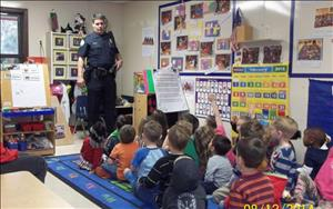 Not just a daddy...but a community hero by protecting us.  A father visits to teach about personal safety.