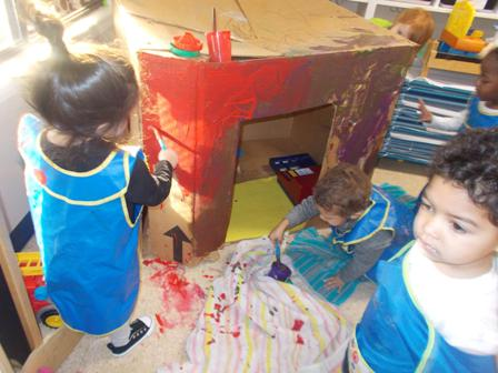 We loved painting a shop for our cars and trucks in preschool.