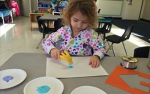 Painting with tools is a fun and creative activity during our Tools and Machines unit.