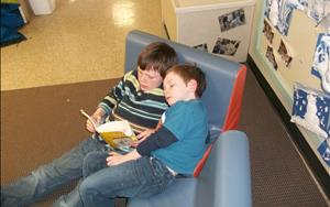 Helping our friends practice reading in the School-Age Classroom.