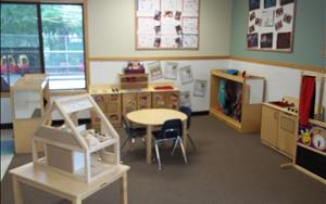We have a large school age classroom that has many areas for the children to explore.  One of the areas that the students enjoy is the dramatic play area.  The children have a large dramatic play area that they get to explore each day.  The dramatic play area includes a doll house, a puppet theater, home living items (fridge, pretend food, stove) as well as items to dress up in.
