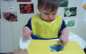Our infants have plenty of opportunities to use creative expression while exploring various art materials such as finger paint.