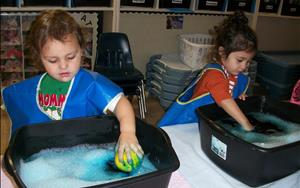 Discovery Preschoolers Helping to Clean Toys