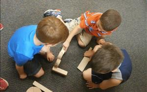 Building together in the blocks center.
