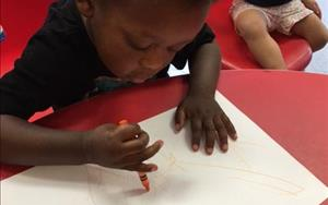 Working hard on drawing his self-portrait!
