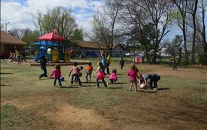 We use our large playground to play games utilizing gross-motor skills.