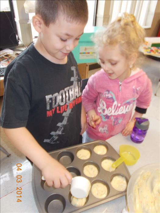 Children are practicing counting and measuring while learning to follow recipe directions in our Cooking Adventures class.