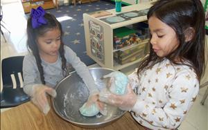 Making playdough is a fun way to get the chlidren involved in the curriculum.
