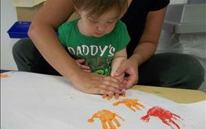 Toddler making a rainbow