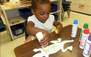 Two's in the Discovery Preschool classroom, work on creative expression and fine motor skills, through daily art projects.