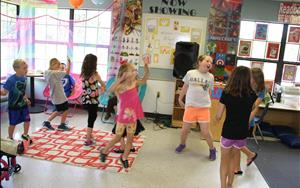 The school-agers have daily dance parties in the drama and music clubs.