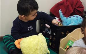 Toddlers love to explore our reading corner with books and puppets!
