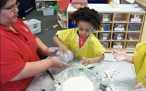 The Pre Kinderarten class was knee deep in a paper mache project for the Dinosaur unit.