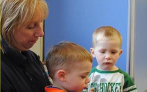 The Discovery Preschool room enjoys a little group time with Ms. Bev