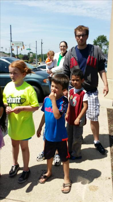 Preschool students are waiting eagerly for snowcones from Kona Ice during our Summer Camp.