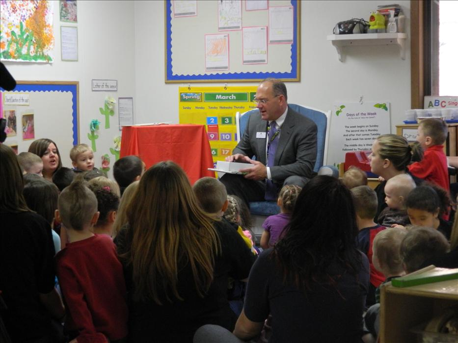Cedar Rapids mayor visits KinderCare to read a book about spring.