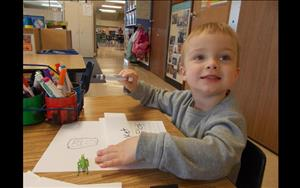 One preschooler shows his excitement while writing about his favorite insect.