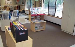 Another area of the classroom that the children enjoy is the blocks and building area.  The children have access to a large carpet where they have blocks, legos and a train set.  During the day the children are allowed to go into the area where they have fun working as a group to build a large train track or building different things with the blocks and legos.