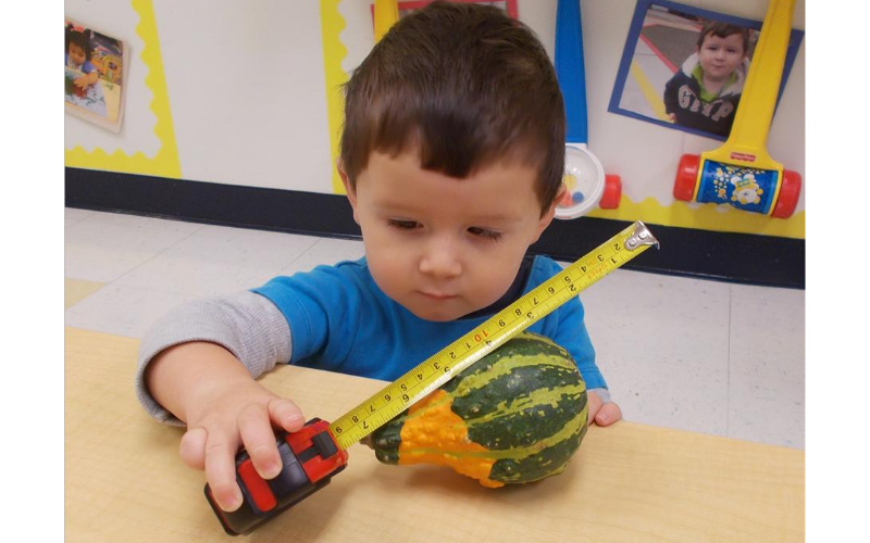 We provide opportunities for toddlers to move about in safe and engaging environments where they can use their natural curiosity to explore beginning math and science concepts.
