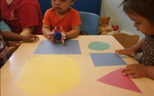 Toddlers learning their shapes.