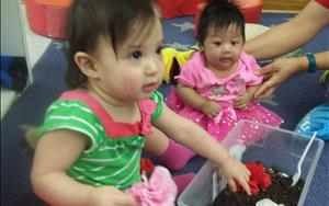 Infants participating in a sensory exploration activity