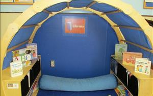 The Prekindergarten book nook is a great place to relax with a good book.