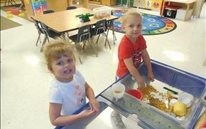 Preschoolers love to play in the sensory table.