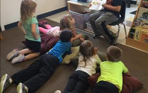 One way we school-agers enjoy our time together, is having story time led by our peers!