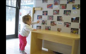 Sophie exploring the word/picture wall (Infant Room)