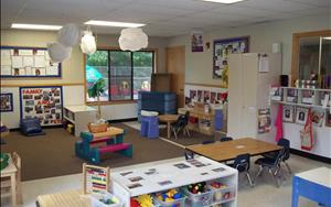 There are two large tables set up in the toddler classroom which is where most meals (breakfast, lunch and PM snack) will take place.  The children also get to have fun in our dramatic play area where we have various items for them to dress up in and pretend play with.  Each month the dramatic play area is going to be transformed into something new that reflects what they are currently learning for the month.