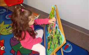 PreKindergarten focuses on many areas including problem solving while learning to complete puzzles.