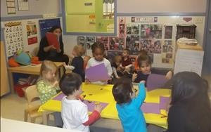 Our Discovery Preschool A classroom participating in teacher guided activities