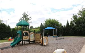 This is the Infant, Toddler, and Discovery Preschool playground which offers opportunites for students to safely develop their gross motor skills.