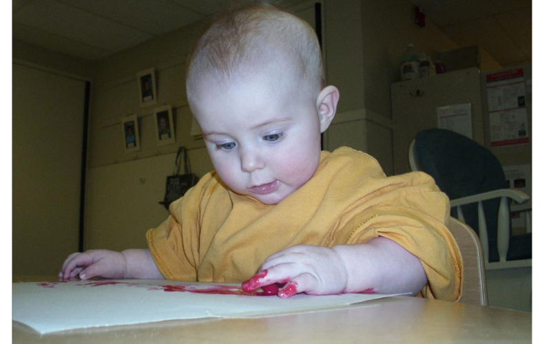 Finger painting in the infant room