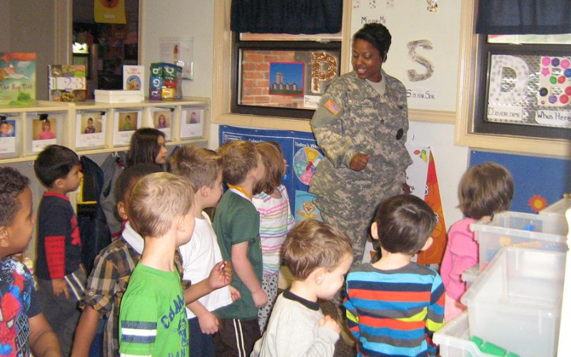 A local veteran visits or KinderCare students.