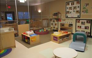 This is our Infant B classroom. The children in this classroom range in age from 12 months-18 months. They are just learning to walk, so we want them to be able to move freely throughout the classroom.
