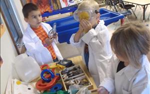 Pretending to be scientists while exploring the science area.