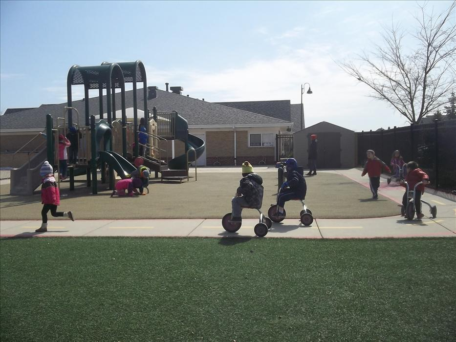 Our Kindergarten enjoying some fresh air and interacting with their friends on the playground!