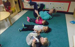 Ms. Crystal is determined to help these toddlers feel calm with some yoga.  Yoga is a great way to build the children's Physical Development while having fun.