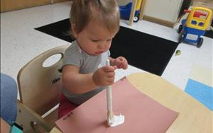 Toddlers Painting with Paintbrushes