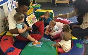 Our infant friends enjoying some circle time with Ms. Ashley and Ms. Manu.