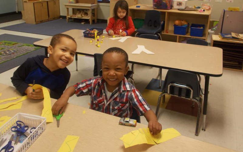 "The Pre-Kindergarten class cuts out yellow paper to create their letter of the week ""Y"" collages."