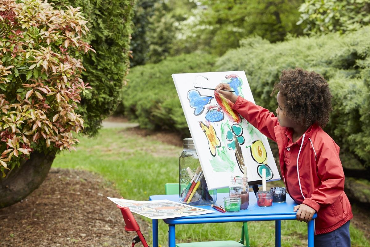 far view of boy painting